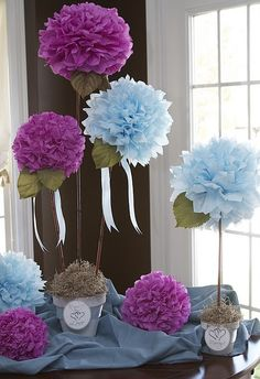 Pom Poms as a cheap centerpiece, instead of just hanging them from the ceiling.  For Chloe's girlie-girl party.