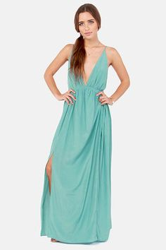Check it out from Lulus.com! No one beholds the beauty of the forest more than you in the Titania's Woods Backless Seafoam Maxi Dress! This breathtaking dress has more than just a touch of magic with silky woven material plunging into a triangle cut bodice followed by a billowy maxi skirt with a slit on the side. Spaghetti straps slip down the backless silhouette and join at the center with wooden bead-embellished ties. Elastic waistband. Lined to mid-thigh. Model is wearing a size small…