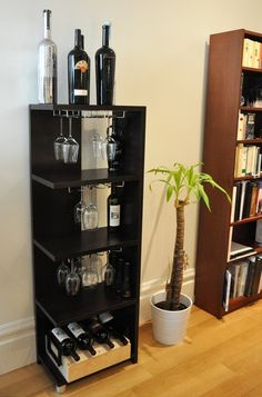 Wine rack made with shelves and Chrome Under-Counter Stemrack ($12) from Pier 1 found on apartmenttherapy.com