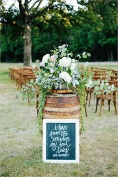 #weddingaisle decor idea: whiskey barrel decor. perfect for a #rustic wedding see more http://static.weddingchicks.com/2015/09/08/white-and-purple-glam-farm-wedding/