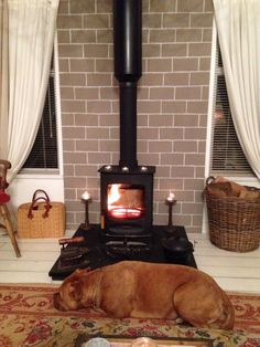 #Charnwood C4 #woodburner installed to a Twin Wall flue system in #FarleyGreen, #Surrey by our #Hetas engineers.