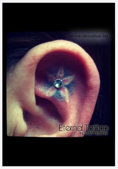 Cartilage piercing integrated with flower tattoo