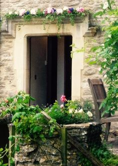 Fresh flower garland over the door of a classic Cotswold Manor House for a perfect country house wedding