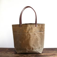 The Jenneng Large Waxed Canvas Tote Bag is lightweight, durable and water resistant.