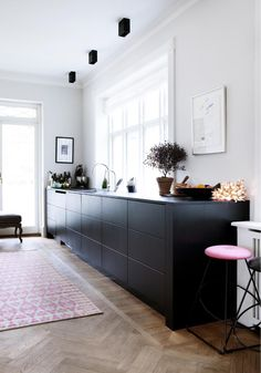 Perfection.. here is my future kitchen.. lights, herringbone timber floors, Black cabinetry and a dash of pink.. Now I just need the timber cottage for it to go in!