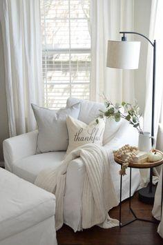 White Slipcovered Chair Living Room. Cozy Living Room Decor Ideas.