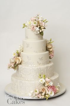 Ron Ben Israel Cakes - five tier wedding cake with lovely lace detail and delicately coloured flowers in soft shades of pink and white.