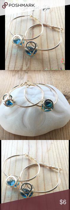 Large hoop earrings Floating Aqua crystal hoop earrings. 💕BUY ONE JEWELRY ITEM AND GET THE SECOND HALF OFF 💕 Jewelry Earrings