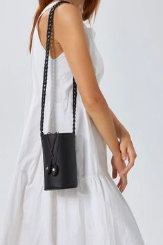 An update to our favorite Roxanne, this bag is reimagined in a mini version with our woven slim strap. It is handmade of top quality leather that comes in black, camel (waxed nubuck), white and taupe canvas with a drawstring closure. Carry it on your shoulder or wear it crossbody, the days you want nothing to weighing you down. It can hold your sunglasses, cell phone, keys and card-wallet. Greek Chic Handmades Women's bags are designed & handcrafted in Athens, Greece from premium leather. Bohemian Style, Boho Chic, Leather Shoulder Bag, Shoulder Bags, Shoulder Strap, Black Leather Bags, Black Camel, Bucket Bag, Card Wallet
