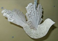 Make this Victorian dove ornament that uses paper doilies for the wings and tail for extra elegance. - Victorian Dove Ornament - Paper Crafts at BellaOnline Paper Doily Crafts, Doilies Crafts, Paper Crafts Origami, Paper Doilies, Victorian Christmas Decorations, Victorian Crafts, Christmas Ornaments To Make, Noel Christmas, Christmas Paper