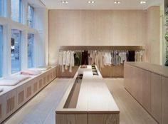 Filippa K store with wooden floor by Dinesen.