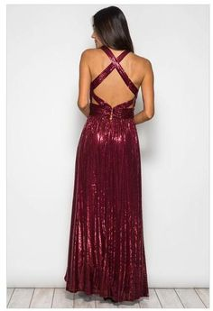 The Play On Curves Red Low Cut Sequin Maxi Dress With Open Back is a party perfect look all by itself!     Plunging V-neckline flows to the empire waistline and figure-flaunting maxi skirt. This dress features a crisscross open back that shows off your sexy side. Hook and eye closure leads to a hidden zipper. Beautiful red sequins shimmer throughout the whole dress.   Fabric: Cotton and Polyester Imported
