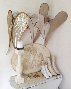 I want a collection of angel wings like this to hang above my bed!!!