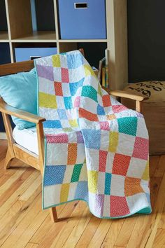 Confetti Candy, by Marcia Eveland, is a generously-sized crib quilt made with pre-cut 5″ squares. Bright colors broken up by white squares are a winning combination for a kid's quilt or baby quilt. And, polka dotted fabrics are just right for this simple easy baby quilt pattern. Sew this one up in a weekend or, for quick quilters, make it in a day!