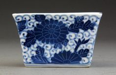 "Chinese Blue and White Porcelain Dish Finely painted with scrolling tendrils and flower motif, base bearing character mark, 2.125""H x 3.375""W."