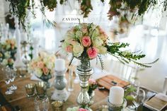 Beautiful wooden tables, tiffany chairs, elegant wedding. green and white flowers, hanging flowers, hanging arrangements. grey candles, candle light, wood, wooden, gold. Zavion Kotze Events Company -Weddings, Luxury Weddings, Bride to be, Wedding day, bride, wedding flowers, wedding hour, wedding season, decor, décor.