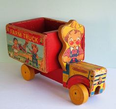 The Campbell Soup Kids as farmers on a 1954 Fisher-Price pull toy.