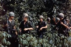 Soldiers of 16th Armor, United States 173 Airborne Soldiers of 16th Armor, United States 173 Airborne Brigade (Seperate) move through dense jungle in a previously unexplored area under Viet Cong control near Ben Cat, north of Saigon, 28 September 1965. The unit was participating in a joint sweep operation in the Binh Duong province of South Vietnam.