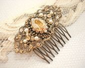 Bridal hair comb, vintage style hair comb with Swarovski golden shadow crystals and Swarovski ivory pearls, vintage stamping, wedding hair. $65.00, via Etsy.