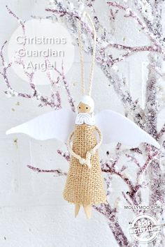 Super cute DIY Christmas tree decoration!  Make this guardian angel from a clothes peg and fabric.