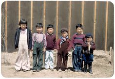 Internment Camp for families of Asian Race in Wyoming. The picture is of a group of children lined up for a photo in front of a barrack wall. Billy Manbo is on the far right. Billies family was forced from their Hollywood, CA home during WWII and after.  It astonishes me how we Americans bully other Ethnic Americans when we feel threatened by others of that same or similar racial/ethnic group. Yet we are constantly making laws to teach children not to do the very thing we adults do daily…