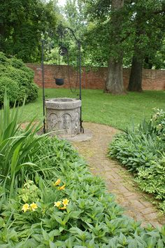 Stone wishing well garden art by KarlGercens.com, via Flickr