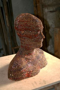 Sculptures Made from Stacked and Welded Euros - Figurative sculptor Gabriel Rufete works with a number of different materials to create delicate, fractured, and often incomplete interpretations of the human form. Here is one of his works with welded euro cent pieces. | #Art #Sculptures #CoinArt |