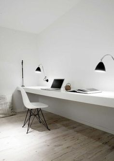 Stark white study area! Love the floating desk attached to the wall!
