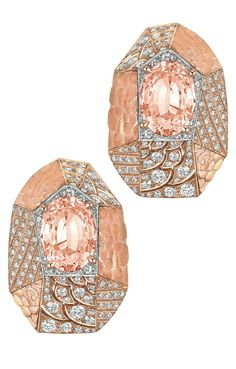 Sunset #Earrings from #CafeSociety - #Chanel - #FineJewelry collection in 18K white and pink gold set with 2 #OvalCut Padparadscha sapphires (5.2 cts) and 305 #BrilliantCut - #Diamonds (3.7 cts) - July 2014