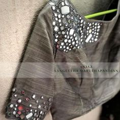 A clustered mirror work designer blouse who knows sometimes the broken pieces of a mirror put together forms an artistic work and you got to love it all over again to bits and pieces. 21 July 2018