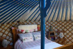 (PHOTO: )  Quirky hideaways for weekends in the country:  Snooze a weekend away in a belle tent in Ireland  These hand-crafted belle tents in Ireland's North Leitrim are beautifully furnished with king size beds, luxurious linens and wood burning stoves. There are also two restored county cottages on the 5 acre woodland site, and plenty of hammocks and safe hiding places to keep children entertained. From €220 for two adults and two children for a two night stay. Open all year round.