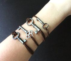 Skeleton Key Bracelet on Rustic Leather Cord by aptoArt on Etsy, $18.00