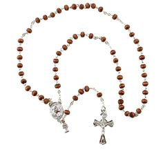 First Communion Brown Wood Rosary,  $25.95. This First Communion rosary features traditional brown wood beads in a small size perfect for a child's hands. A Sacred Heart medal center is complemented with a host and chalice charm. The neutral brown wood beads make this a traditional choice idea for either a boy or girl making their First Holy Communion.