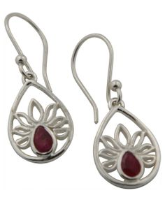 The lotus flower, like our spiritual selves, must first rise through layers of muck before blossoming in the sunlight. These artistically minimalist earrings are made of sterling silver with corundum ruby accents, and each earring measures 1.25 inches