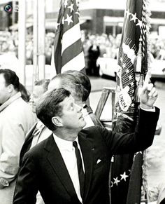 President John F. Kennedy indicates that his wife, first lady Jacqueline Bouvier Kennedy, is still inside the hotel behind him as he attends a political rally in Fort Worth, Texas several hours before his assassination in this November 22, 1963 photo by White House photographer Cecil Stoughton RIP♡❀♡RIP http://en.wikipedia.org/wiki/Timeline_of_the_John_F._Kennedy_assassination