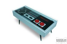 Hey, I found this really awesome Etsy listing at http://www.etsy.com/listing/101226332/nintendo-controller-coffee-table