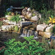 A dramatic two-tier waterfall starts in one corner of this yard and flows along a 15-foot curve that empties into a pond 15 feet long and 7 feet across at its widest points. See the whole yard here!   Photo: Linda Oyama Bryan   thisoldhouse.com