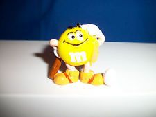 M&M's CAVEMAN Yellow HEAD SCRATCHER EGG Figurine M&M French Pocket Surprise M&Ms