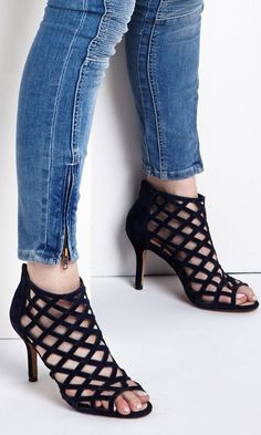 Luxurious suede caged mid heels with an ultra-cushioned sole (carefully constructed for extra comfort), peep toe front and easy back zipper.