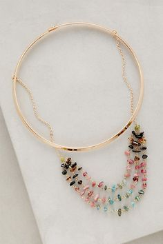 "Luminosities Necklace #anthropologie;       13""L     0.25""W, 5"" diameter       Metal, tourmaline     Hook-and-eye closure     Imported      Style No. 35480367"