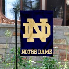 University of Notre Dame Garden Flag is 13x18 inches in size, made of 2-ply poly, and screen printed University of Notre Dame logos and...