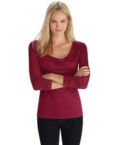Feminine drapes layer down from the neckline on this form fitting long sleeve top with blissful stretch. Simple yet sassy in deeply desirable hue that will coordinate effortlessly with a printed pant or skirt.