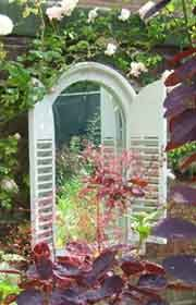 This mirror the garden really makes a difference to this long dull wall