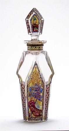 1920s Rigaud Pres de Vous perfume bottle and stopper, clear glass, translucent enamel in stained glass effect with Heraldic figures and labeling. 6 in.