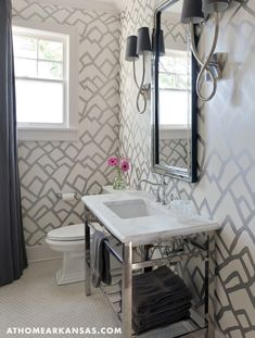 Black and silver bathroom features walls clad in silver geometric wallpaper, Schumacher Medina Silver Wallpaper, alongside a drop-in tub and shower combo finished with a black and white geometric shower curtain. Interior Exterior, Bathroom Interior Design, Bathroom Designs, Interior Ideas, Bathroom Ideas, Silver Bathroom, Funky Bathroom, Bathroom Plumbing, Bathroom Black
