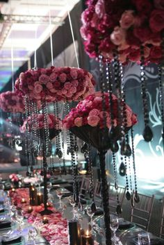 Multi-hued pink roses with black accents make for a glamorous conversation piece at this Amman wedding. At Four Seasons Hotel Amman.