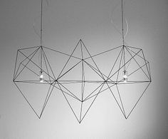 What a lovely chandelier. I love the delicate string-like construction of it. I can just imagine it over a clean, minimal dining table.