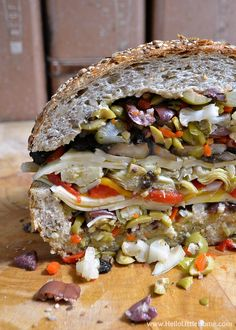 This Vegetarian Muffaletta Sandwich has all the amazing flavors of the original without any meat Hello Little Home Veggie Sandwich, Sandwich Recipes, Veggie Recipes, Whole Food Recipes, Vegetarian Recipes, Cooking Recipes, Healthy Recipes, Vegetarian Dinners, Vegetarian Cooking