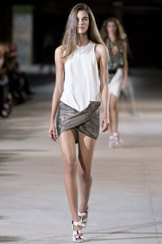 her skirt tumbles out of her pocket like a magician's inadvertent fumble...and she saves the day with an elegant wrap