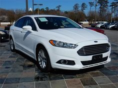 2015 FORD FUSION SE  33735 miles, White exterior color with a Black interior, Automatic Transmission, Stock # 14704,
